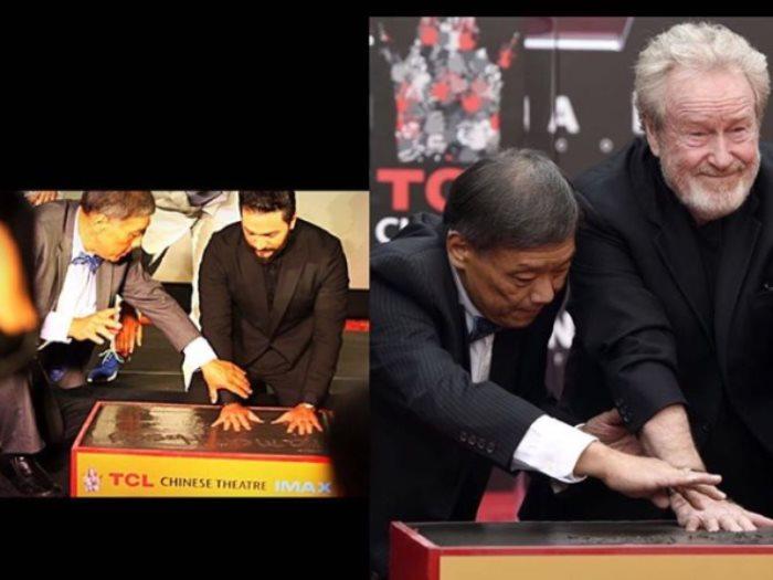 تامر حسنى و ريدلي سكوت أثناء تتويج أسمهما بالمسرح الصينى