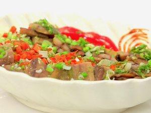 بتاكلها مخلية ولا بالسلطة.. طريقة جديدة لإعداد طبق الرنجة بأول يوم العيد